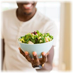 Photo of a salad bowl held in a man's hand