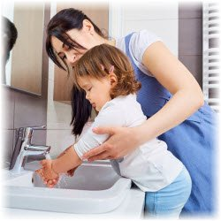 Photo of mom teaching child to wash hands