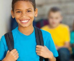 boy with back pack for back to school