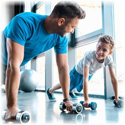 Photograph of a father and young son doing push-ups together