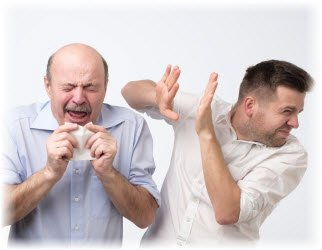 Photo of man sneezing on another man