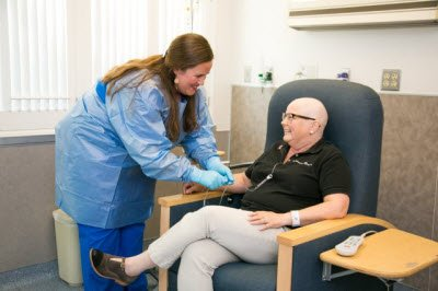 Nurse assisting patient with cancer