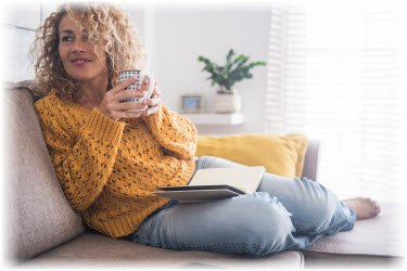 Photo of woman drinking a cup of tea