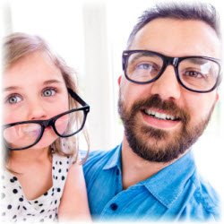 Photo of dad and daughter in eye glasses