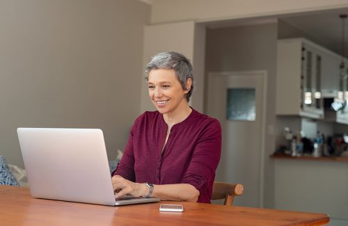 Photo of woman at computer