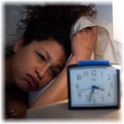 Photo of woman unable to sleep