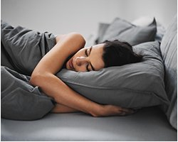 Photo of woman sleeping comfortably in her bed
