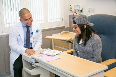 Doctor going over patient options with patient