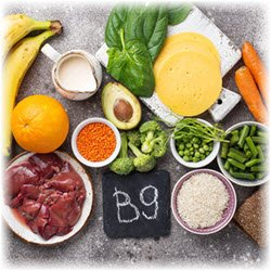 "Photo of various fruits and vegetables surrounding a chalkboard with ""B9"" written on it"