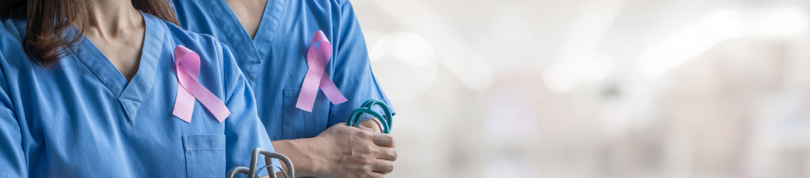 Photo of two doctors wearing Breast cancer awareness ribbons