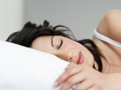 Woman sleeping - get a better night's sleep