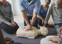 Photo of a group learning CPR