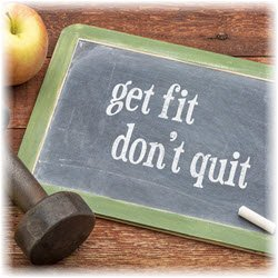 "Photo of a handheld chalkboard that reads ""get fit don't quit"""