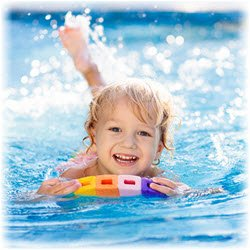 Photo of a child swimming in a pool