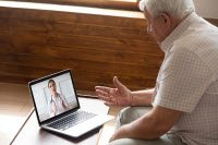 Photo of man on telehealth visit