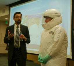 Dr. McCarthy and Carole Snyder demonstrating personal protective equipment