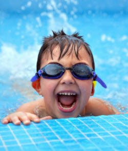 Pool safety, young boy in swimming pool